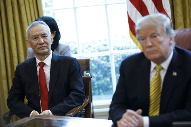 Visiting Chinese Vice Premier Liu He meets with U.S. President Donald Trump inside the Oval Office of the White House in Washington, DC, USA, 04 April 2019. [Photo: IC]