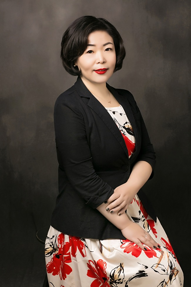 Wang Qian, an insurance agent based in Beijing. [File photo provided to China Plus]