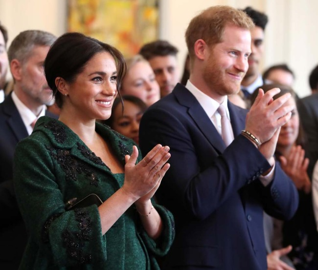 Meghan, Duchess of Sussex (L) and Britain's Prince Harry, Duke of Sussex, watch a musical performance at Canada House, the offices of the High Commission of Canada in the United Kingdom, during an event to mark Commonwealth Day, in central London, on March 11, 2019. [Photo: AFP]