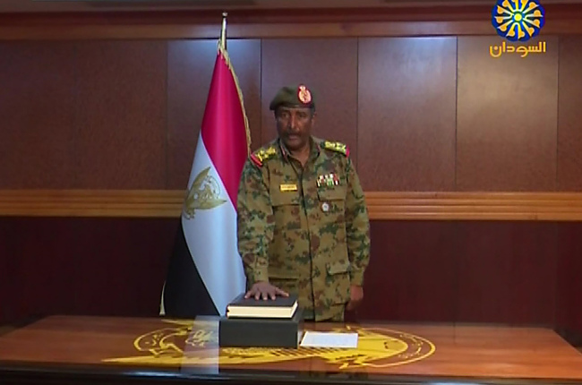 A grab from a broadcast on Sudan TV shows General Abdel Fattah al-Burhan Abdulrahman taking oath on April 12, 2019 as chief of the new military council, in the capital Khartoum. Sudan's military council chief General Awad Ibn Ouf announced on April 12 he was stepping down in favour of General Abdel Fattah al-Burhan Abdulrahman to succeed him, just a day after he was sworn in following the ouster of veteran president Omar al-Bashir. [Photo: Sudan TV via AFP]