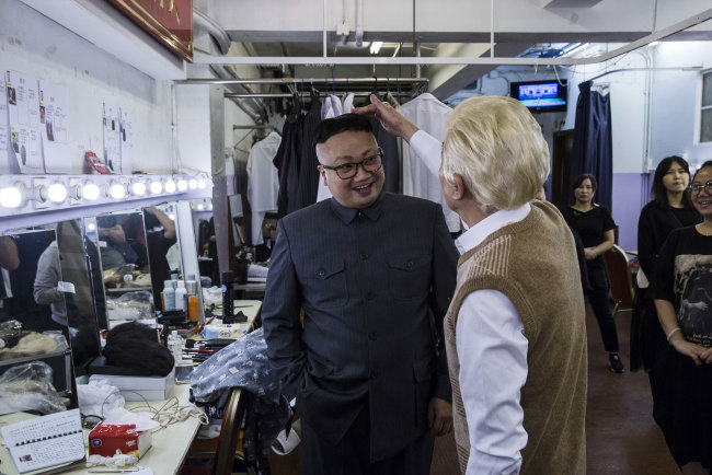 "Chan Hung-chun (C), dressed as North Korean Leader Kim Jong-un, reacts with follow actors back stage during a rehearsal of a Cantonese opera called ""Trump on Show"", in Hong Kong on April 11, 2019. [Photo:AFP]"