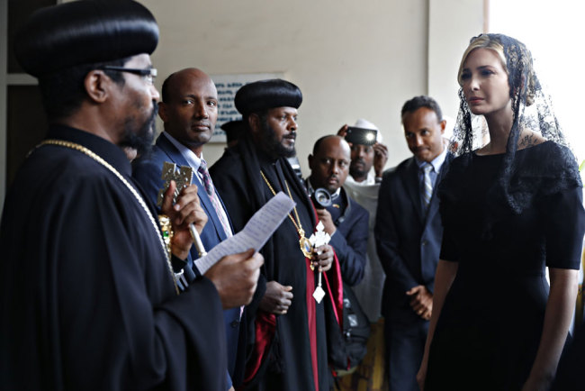 White House senior adviser Ivanka Trump, right, is greeted as she arrives for a ceremony at Holy Trinity Cathedral honoring the victims of the Ethiopian Airlines crash, Monday April 15, 2019, in Addis Ababa, Ethiopia. [Photo: AP/Jacquelyn Martin]
