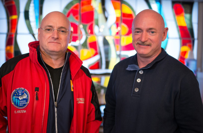 NASA Astronaut Scott Kelly, left, and his identical twin brother Mark Kelly, pose for a graph Thursday, March 26, 2015 at the Cosmonaut Hotel in Baikonur, Kazakhstan. [Photo: IC]
