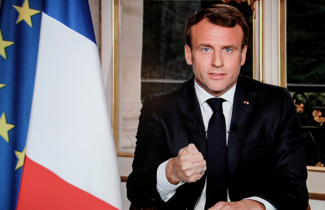 The screen shot made on April 16, 2019 shows French President Emmanuel Macron addressing the nation on French private TV channel TF1 during which he vows to rebuild Notre-Dame de Paris Cathedral within five years. [Photo: AFP/ludovic Marin]