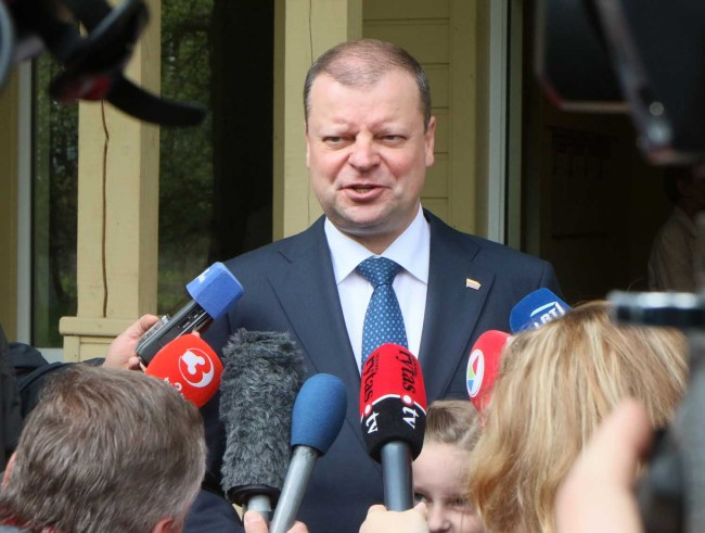 Lithuania's Prime Minister Saulius Skvernelis, talks to journalists during the presidential election in Vilnius on May 12, 2019. [Photo: AFP]
