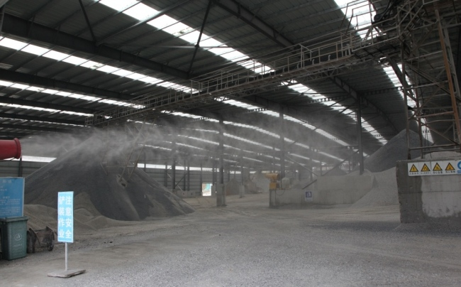 The water spray equipment in one of Changyin's factories is working to contain the dust created during the processing of raw stone. [Photo: Chinaplus]