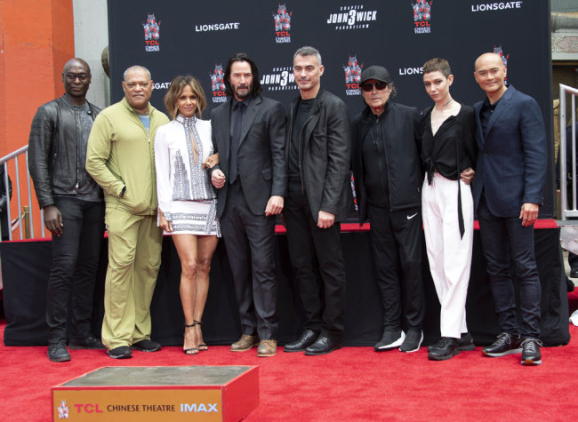 (L-R) Lance Reddick, Laurence Fishburne, Halle Berry, Keanu Reeves, Director Chad Stahelski, Ian McShane, Asia Kate Dillon and Mark Dacascos attend a handprint ceremony honoring Keanu Reeves at the TCL Chinese Theatre IMAX forecourt on May 14, 2019 in Hollywood, California. [Photo: AFP/Valerie Macon]