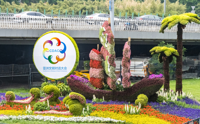A view of the Conference on Dialogue of Asian Civilizations themed flower garden is showed in downtown Beijing on May 15, 2019. [Photo: IC]