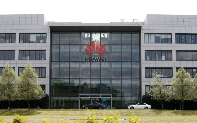 The Huawei logo and signage at their main UK offices in Reading, west of London, on April 29, 2019. [Photo: AFP]