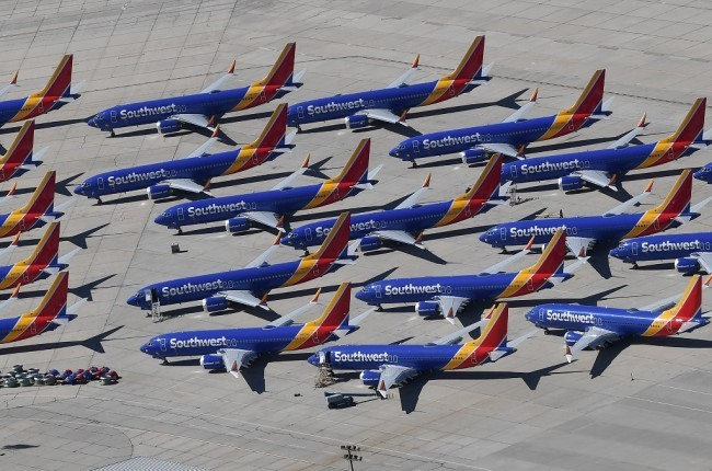 Southwest Airlines Boeing 737 MAX aircraft are parked on the tarmac after being grounded, at the Southern California Logistics Airport in Victorville, California on March 28, 2019. [File Photo: AFP]
