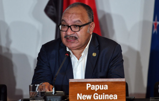 In this file photo taken on November 18, 2018 Papua New Guinea's Prime Minister Peter O'Neill speaks at an electricity projects signing ceremony during the Asia-Pacific Economic Cooperation (APEC) Summit in Port Moresby. O'Neill resigned on May 26, 2019. [Photo: AFP/Saeed Khan]