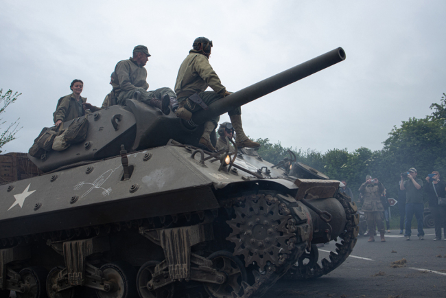 Reenactors drive a tank during a parade not far from Sainte Mere Eglise, northern France, to celebrate the 75th anniversary of the D-Day landing, on June 4, 2019. [Photo: AFP/Federico Scoppa]