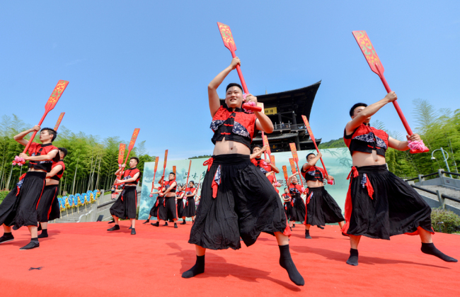 People dance to celebrate this year's cultural and natural heritage day, which falls on June 8, 2019. [Photo: IC]