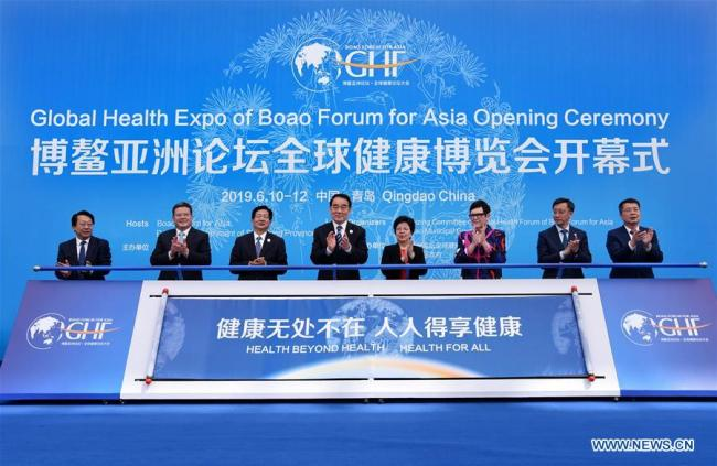 """Delegates attend the opening ceremony of the Global Health Forum (GHF) of Boao Forum for Asia (BFA) at Qingdao World Expo City in Qingdao, east China's Shandong Province, on June 10, 2019. Themed with """"Universal Health Coverage,"""" """"Innovation"""" and """"Health in All Policies,"""" the three-day forum will focus on Internet plus healthcare, the industrial transformation of technology innovations, traditional medicine and the development of the health service industry. [Photo: Xinhua/Li Ziheng]"""