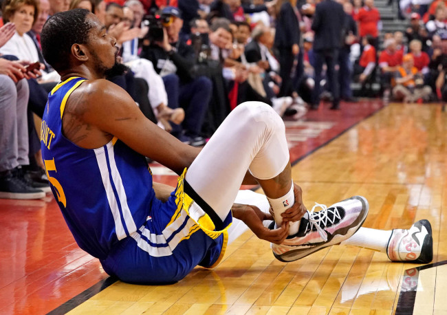 Golden State Warriors forward Kevin Durant (35) sits on the court after an injury during the second quarter in Game 5 against the Toronto Raptors of the 2019 NBA Finals in Toronto, Monday, June 10, 2019. [Photo: IC]