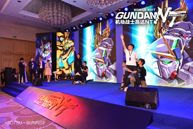 "Gundam fans in China imitate the classic movements of ""Mobile Suit Gundam Narrative"" at an event on Tuesday, June 11, 2019 to celebrate the collaboration between film and entertainment companies in China and Japan.[Photo: China Plus]"
