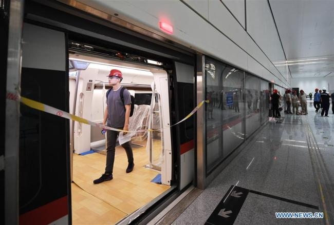A journalist visits a train of the new airport subway line in Beijing, capital of China, June 15, 2019. [Photo: Xinhua]