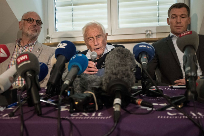 Australian scientist David Goodall attends a press conference flanked by Exit International founder and director Dr. Philiip Nitschke (L) and Dr. Moritz Gall (R) on May 9 2018, on the eve of his assisted suicide in Basel. A 104-year-old Australian scientist David Goodall, resentful that he was forced overseas to die, gave a press conference along side Gall and Exit International founder and director Dr. Philiip Nitschke in Switzerland a day before he is due to end his life. Goodall does not have a terminal illness but says his quality of life has deteriorated and that he wants to die. Goodall, who according to Exit International attempted but failed to commit suicide on his own earlier this year, secured a fast-track appointment with assisted dying foundation Eternal Spirit in Basel. [File photo: AFP/Sebastien Bozon]