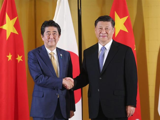 Chinese President Xi Jinping (R) meets with Japanese Prime Minister Shinzo Abe in Osaka, Japan, June 27, 2019. [Photo: Xinhua]
