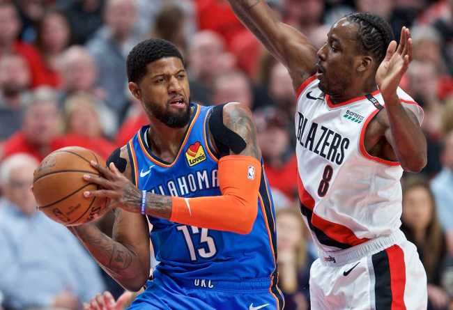 In this April 16, 2019, file photo, Oklahoma City Thunder forward Paul George (L) looks to pass the ball around Portland Trail Blazers forward Al-Farouq Aminu during the first half of Game 2 of an NBA basketball first-round playoff series in Portland, Oregon, U.S. [Photo: IC]