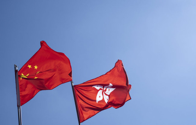 The national flag of China and the regional flag of Hong Kong Special Administrative Region. [File photo: IC]
