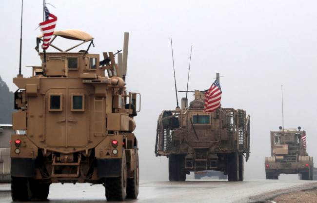 Photo taken on December 30, 2018, shows a line of U.S. military vehicles in Syria's northern city of Manbij. [File photo: VCG]