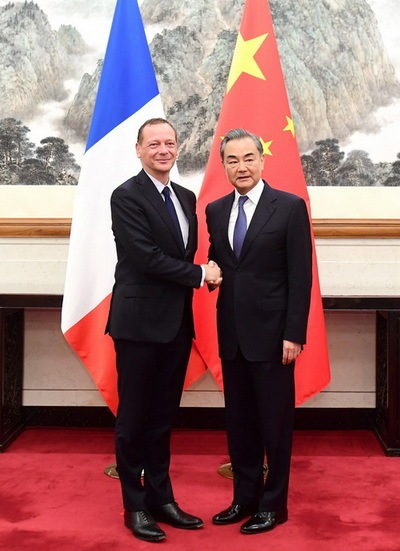 Chinese State Councilor and Foreign Minister Wang Yi meets visiting French president's diplomatic counselor Emmanuel Bonne in Beijing on Friday, July 19, 2019. [Photo: gov.cn]