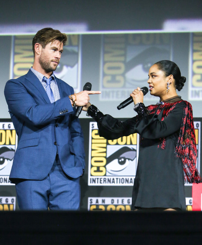 The cast of Thor, Chris Hemsworth and Tessa Thompson on stage during the Marvel Comic Universe Panel on Day 3 of Comic Con 50 in San Diego, CA, July 20, 2019. [Photo: IC]