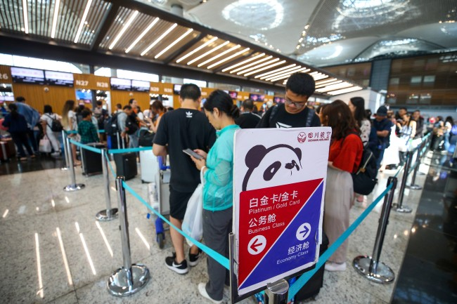 Passengers for the Sichuan Airlines flight from Istanbul to Chengdu flight waiting in line at Istanbul Airport in Turkey on Thursday, August 1, 2019.[File Photo: Anadolu Agency via IC/Muhammed Enes Yildirim]