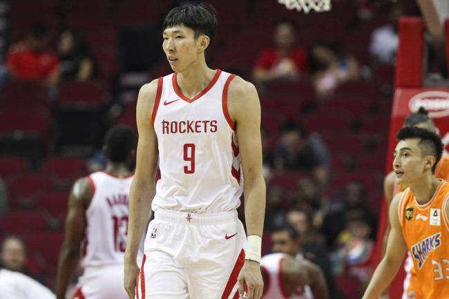 Houston Rockets forward Zhou Qi (9) reacts after a play during the first quarter against the Shanghai Sharks at Toyota Center in Houston on Oct 9, 2018. [File photo: IC]