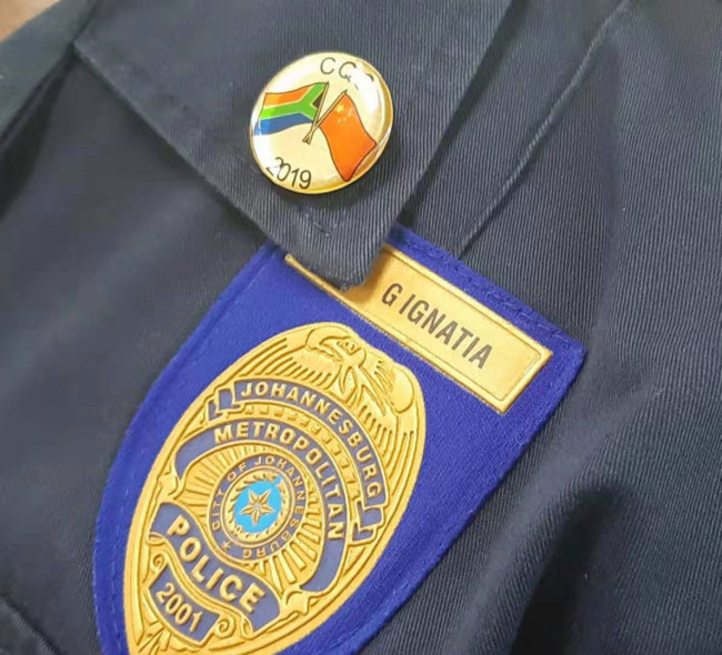 The new Unarmed Defense and Control badge of the Johannesburg Metro Police Department. [Photo: Joburg Public Safety]