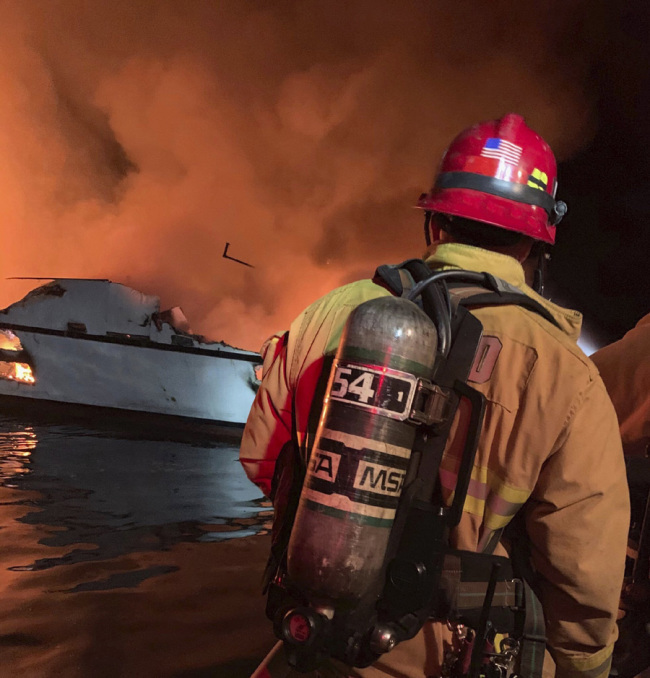 In this photo provided by the Ventura County Fire Department, VCFD firefighters respond to a boat fire off the coast of southern California, Monday, September 2, 2019. [Photo: Ventura County Fire Department via AP]