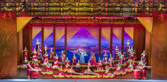 The whole country rejoicing upon Xuan Zang's return in 645 AD in the Tang Dynasty. A Tang orchestra without a huqin is restored to portray Tang people, consisting of nearly forty instrumentalists that are played with plucked strings, wind instruments and percussion. [Photo courtesy of CNTO]