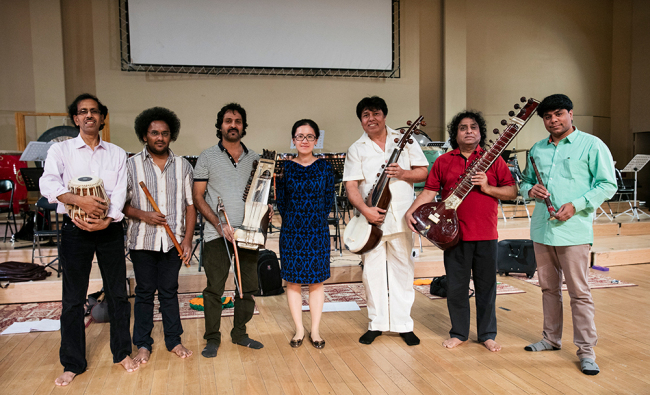 Jiang Ying (middle), the composer and director of 'Xuan Zang's Pilgrimage' with musicians from India. [Photo courtesy of CNTO]