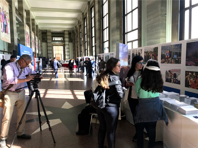 "Visitors at the exhibition ""Pursuing Happiness for the People: China's 70 years of human rights achievements on display"" in Geneva, Switzerland, on Monday, September 9, 2019. [Photo: China Plus]"