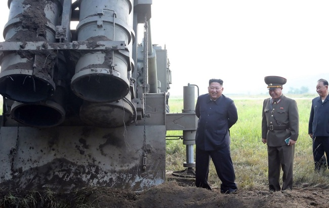 "This picture taken on September 10, 2019 and released by DPRK's official Korean Central News Agency (KCNA) on September 11, 2019 shows DPRK top leader Kim Jong Un attending the testing of a ""super-large multiple rocket launcher"" at an undisclosed location in the country. [Photo: KCNA via VCG]"