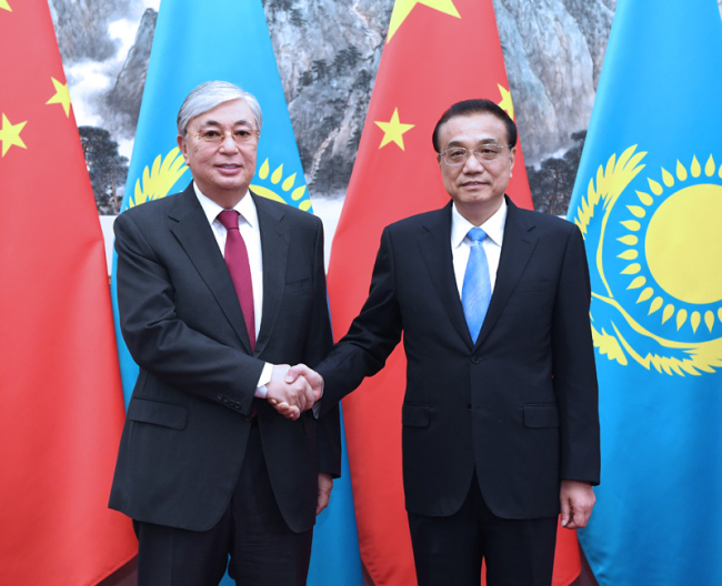 Chinese Premier Li Keqiang (right) meets with Kazakh President Kassym-Jomart Tokayev in Beijing on September 11, 2019. [Photo: Xinhua]