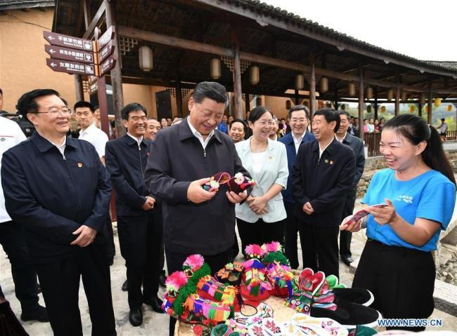 Chinese President Xi Jinping, also general secretary of the Communist Party of China Central Committee and chairman of the Central Military Commission, learns about building the town of Chuangke, or makers, and promoting rural tourism and rural revitalization by red tourism resources at Tianpudawan in Tianpu Township of Xinxian County, central China's Henan Province, Sept. 16, 2019. [Photo: Xinhua]