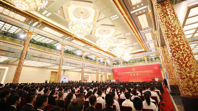 A presentation ceremony for national medals and honorary titles is held on September 29, 2019, at the Great Hall of the People in Beijing. [Photo: Xinhua]