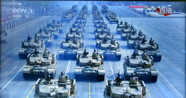 Military vehicles are seen during a military parade celebrating the 70th founding anniversary of the People's Republic of China (PRC) in Beijing, capital of China, Oct. 1, 2019. [Photo: China Plus]