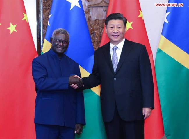 Chinese President Xi Jinping meets with Solomon Islands' Prime Minister Manasseh Sogavare at the Diaoyutai State Guesthouse in Beijing, Oct. 9, 2019. [Photo: Xinhua/Yao Dawei]