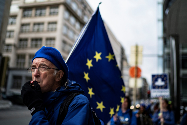 An anti-Brexit activist protests near the European Parliament building in Brussels on October 09, 2019. [File Photo: AFP/Kenzo Tribouillard]