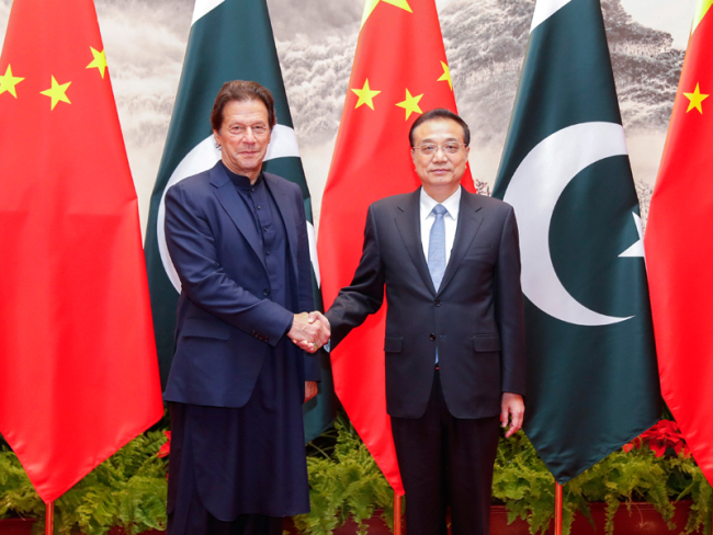 Chinese Premier Li Keqiang meets with visiting Pakistani Prime Minister Imran Khan in Beijing, capital of China, Oct. 8, 2019. [Photo: gov.cn]