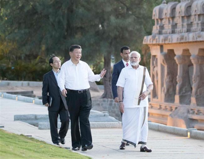 Indian Prime Minister Narendra Modi gives Chinese President Xi Jinping a guided tour of the Group of Monuments at Mahabalipuram, India, Oct. 11, 2019. [Photo: Xinhua/Wang Ye]