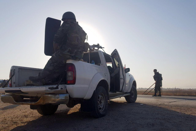 In this photo released by the Syrian official news agency SANA, Syrian troops deploy in the northern town of Tal Tamr, Monday, Oct 14, 2019. The move toward Tal Tamr came a day after Syria's Kurds said Syrian government forces agreed to help them fend off Turkey's invasion. [Photo: SANA via AP]