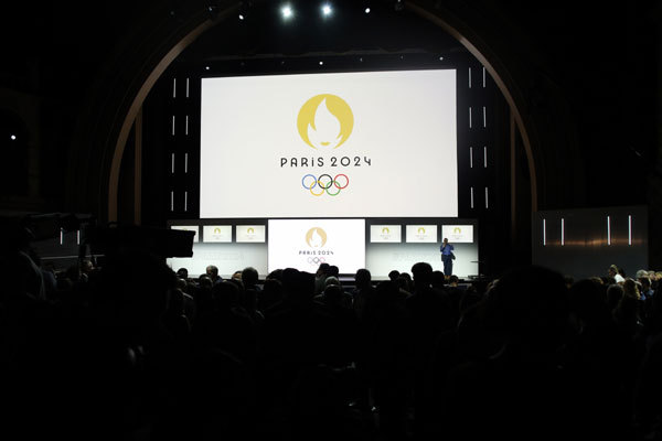 Paris 2024 Olympic logo is displayed on a screen during a ceremony, in Paris, Monday, October 21, 2019. [Photo: Imagine China]