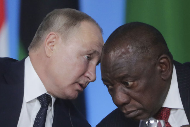 Russian President Vladimir Putin, left, talks with South African President, Cyril Ramaphosa during a plenary session at the Russia-Africa summit in the Black Sea resort of Sochi, Russia, Thursday, Oct. 24, 2019. [Photo: AP]