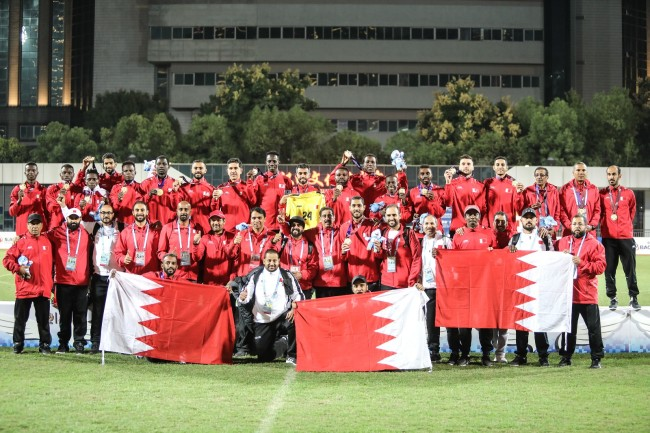 Members of the Bahraini football team pose for photos after winning the gold medal at the Military World Games in Wuhan on Saturday, October 27, 2019. [Photo provided to China Plus]