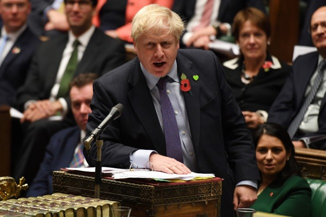 A handout picture released by the UK Parliament shows Britain's Prime Minister Boris Johnson speaking during the weekly Prime Minister's Questions (PMQs) in the House of Commons in London on October 30, 2019. [Photo: AFP]