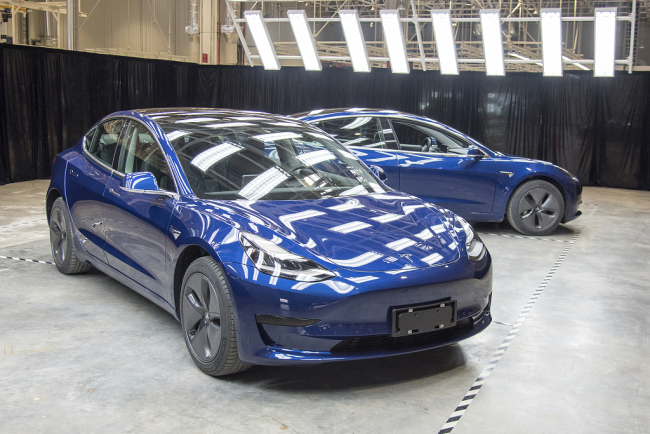 Tesla's Model 3 sedans are seen in its Shanghai gigafactory on November 7, 2019. [File photo: VCG]